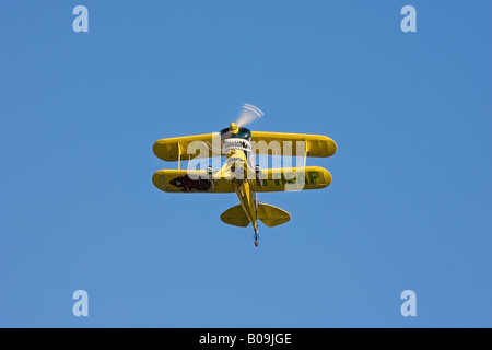 Pitts S-1S Special G-REAP aerobatic biplane in flight against a blue sky - Stock Photo