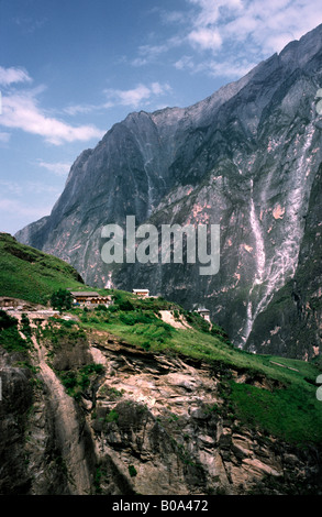 Aug 10, 2006 - View of a Naxi minority village at Tiger Leaping Gorge near Qiatou in the Chinese province of Yunnan. - Stock Photo