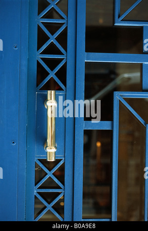 Metal and glass door with handle, close-up - Stock Photo