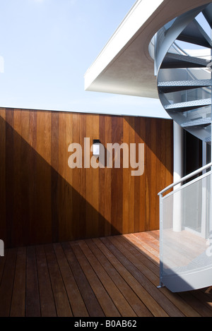 Wooden patio with spiral staircase - Stock Photo