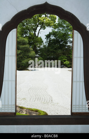 Window with view of Japanese rock garden - Stock Photo
