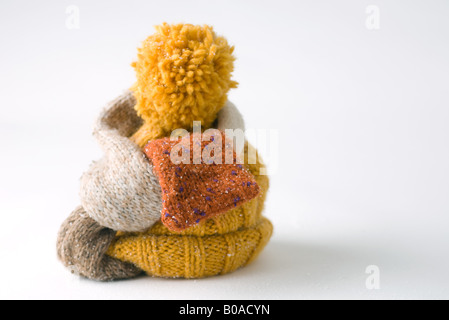 Scarf wrapped around knit hat, close-up - Stock Photo