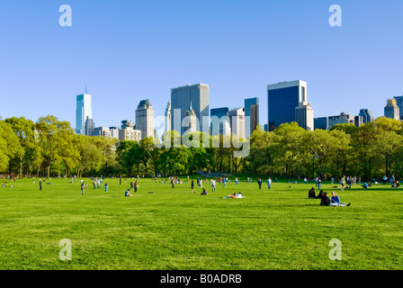 New York City. Central Park in springtime at the Sheep Meadow with view of Midtown Manhattan Skyline. - Stock Photo