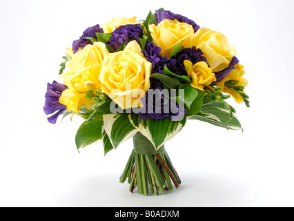 A bouquet of arranged flowers Yellow roses hybrid tea rose and Yellow freesia buds - Stock Photo