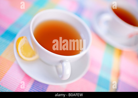 A view of a cups of tea and a lemon - Stock Photo