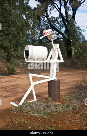 A mailbox at the entrance to a farm in rural Australia - Stock Photo