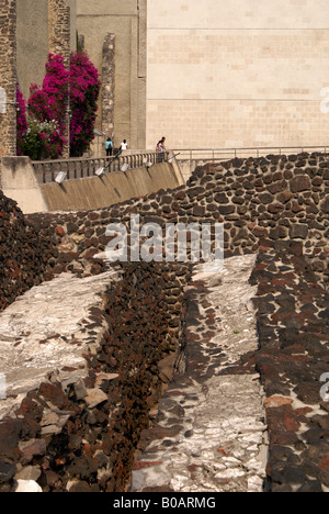 Tourists looking at the ruins of the Templo Mayor or Aztec Great Temple of Tenochtitlan, Mexico City - Stock Photo