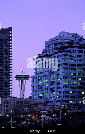 Space Needle rising above buildings of downtown Seattle Washington USA - Stock Photo