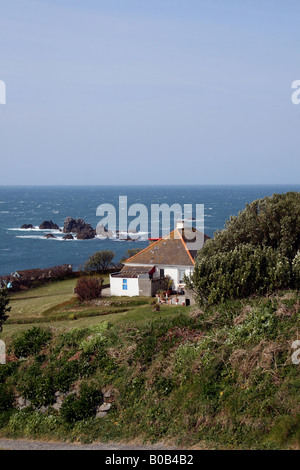THE COASTLINE AND MOST SOUTHERLY HOUSE IN UK AT LIZARD HEAD ON THE CORNISH COAST. CORNWALL ENGLAND. - Stock Photo