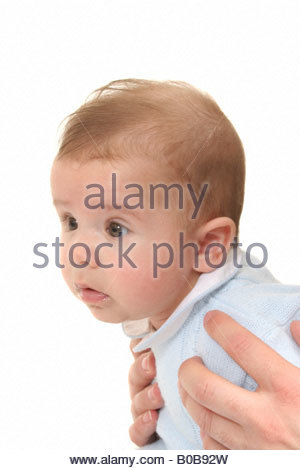 A 4 month baby being held up. - Stock Photo