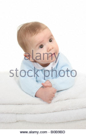A 4 month baby on his tummy. - Stock Photo