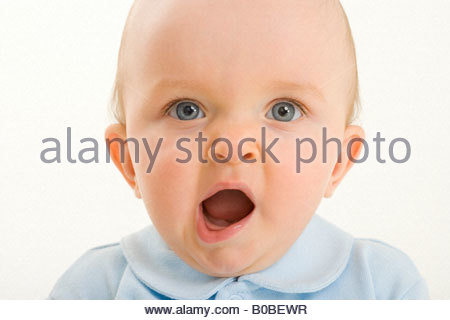 Baby boy 3-6 months yawning, close-up - Stock Photo