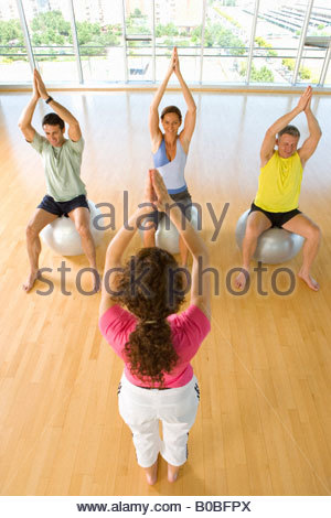 People taking exercise class with exercise balls, elevated view - Stock Photo
