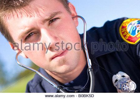 Paramedic with stethoscope, portrait, close-up - Stock Photo