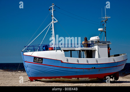 Fishing boat on the beach waiting for the next job stock for Fishing boat jobs