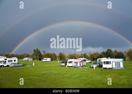 Rainbow over the Camping and Caravanning Club campsite, Kessingland, Suffolk, England - Stock Photo