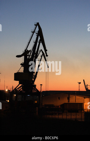 Reloading cranes in harbour in the evening, Wismar, Germany - Stock Photo