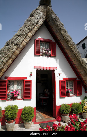 A-framed house or Palheiros are traditional Madeiran homes found in the town of Santana. - Stock Photo