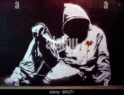 Hoodie with knife, faceless hooded teenager - an image from The Cans Festival, a London street exhibition Banksy - Stock Photo