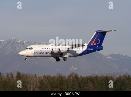 Brussels Airlines Avro RJ85 regional airliner landing at Ljubljana Airport. Air travel in Europe. - Stock Photo