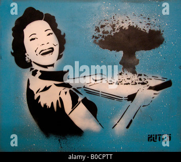 Retro woman wife serves atom bomb on platter - image from The Cans Festival, street exhibition that artist Banksy - Stock Photo