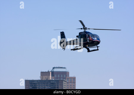 A helicopter lands at the Manhattan Heliport in lower Manhattan, New York - Stock Photo