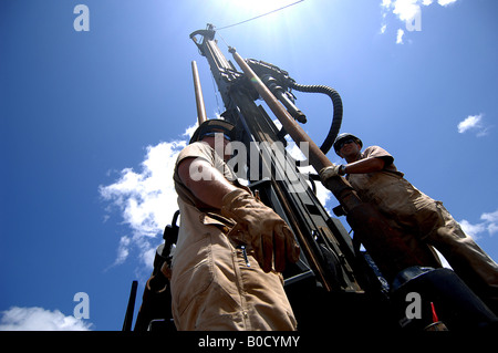 Seabees from Naval Mobile Construction Battalion assemble a rig during a well drilling project in Shaba Kenya - Stock Photo