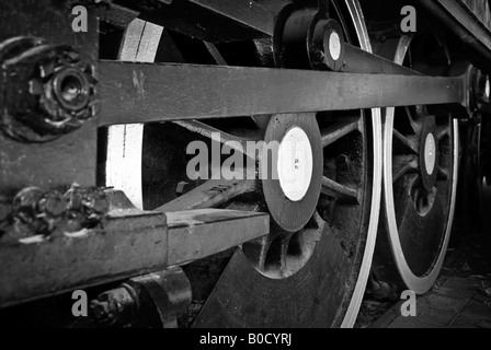 great steam train locomotive wheels closeup image in black and white - Stock Photo