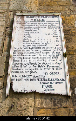 Old tolls board for weekly market in Moreton in Marsh Cotswolds Gloucestershire England UK EU - Stock Photo