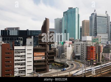 View of Shiodome and a Shinkansen bullet train at Shimbashi Station Tokyo Japan - Stock Photo