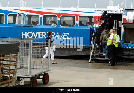 Passengers boarding Hovercraft Freedom 90 GH 2114 of the Hovertravel Fleet enroute to Portsmouth Southern England - Stock Photo