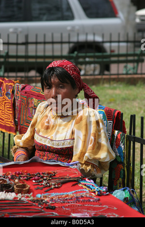 Kuna indian woman selling chaquiras at a street market of Panama City.  For Editorial Use Only. - Stock Photo