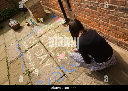 UK Cheshire Knutsford Royal May Day Amy Bishop sanding message outside heritage centre - Stock Photo