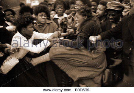 Street fights women girls violence disorder fury - London England 1970s - Stock Photo