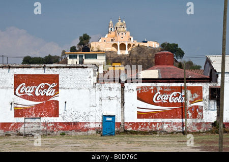 The church of Nuestra Señora de los Remedios, sitting on top of the hidden pyramid in Cholula, Mexico. Signs for - Stock Photo