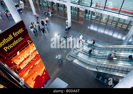 CH Switzerland Zurich Kloten The Zurich airport the Skymetro station at Terminal E passengers are going to the Gates - Stock Photo