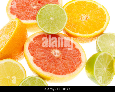 Selection OF Fresh Healthy Ripe Juicy Citrus Fruits Including Pink Grapefruit limes Lemons And Oranges Isolated - Stock Photo