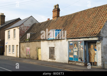 Village store shop and houses closed down empty Chatteris Cambridgeshire UK HOMER SYKES - Stock Photo