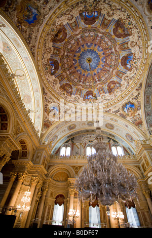 Grand Euro style Ceremonial Hall. The domed decorated ceiling and massive chandelier of the ballroom of this over - Stock Photo