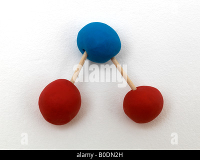 Carbon Dioxide Molecule made by Student from Modelling Clay and Cocktail Sticks - Stock Photo