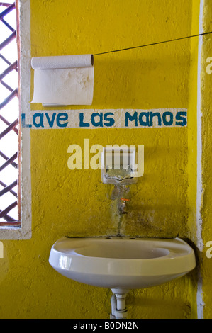 Brightly coloured yellow entrance to toilets in a cafe near the entrance to Coba ruins, Mexico - Stock Photo