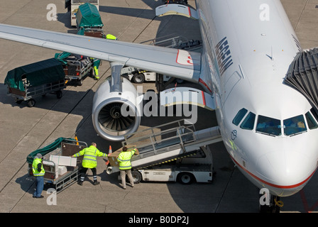Freight being loaded onto an Aegean Airlines passenger aircraft at Dusseldorf International Airport, Germany. - Stock Photo
