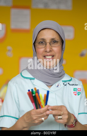 Portrait of a child care assistant UK - Stock Photo