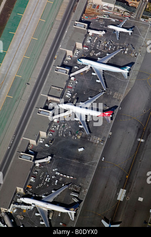aerial above loading and unloading airliners at Los Angeles International Airport LAX, California - Stock Photo