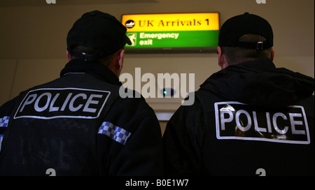 Police officers on duty in Uk airport - Stock Photo