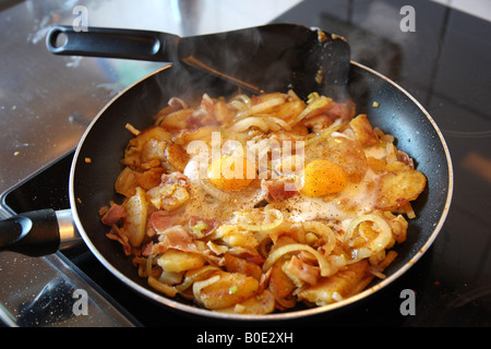 Fried Potatoes With Onions Fried Egg In A Pan Stock Photo