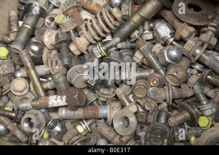 left over nuts, bolts and washers in an automotive workshop - Stock Photo