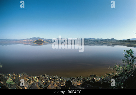 Lake Logipi and reflections in the Suguta Valley Northern Kenya East Africa - Stock Photo