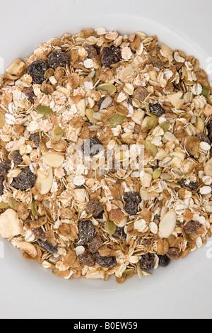 Organic muesli with fruit and nuts London England United Kingdom - Stock Photo