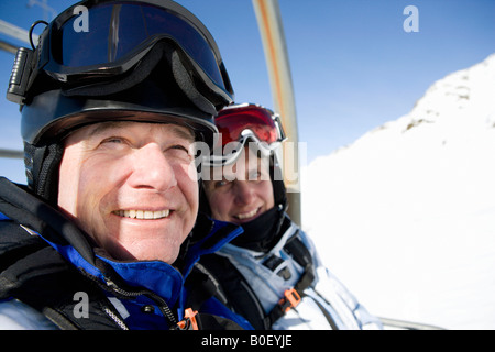 Couple on chair lift - Stock Photo